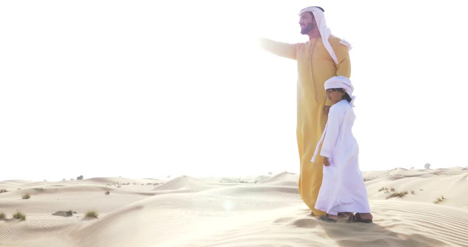 Father and son playing together in the desert. Family doing a safari in Dubai | Shutterstock HD Video #1017816454