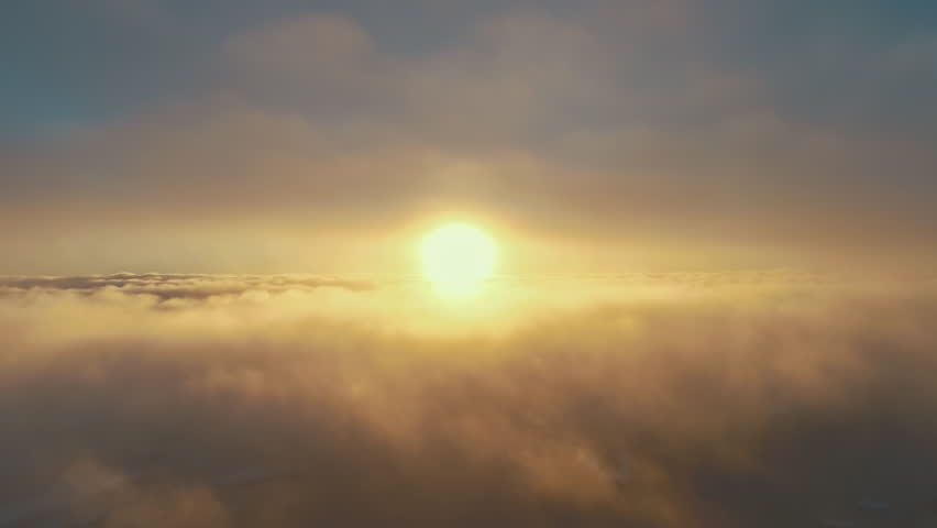 Sunset, fog clouds. Aerial drone flight view. Epic panoramic overview the bright orange sun above the fast moving surface fog covering Antarctic continent. Overwhelmed sky scape. 4k footage. | Shutterstock HD Video #1017822364