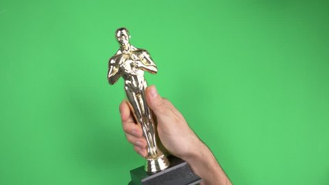 MONTREAL, CANADA - September 2018 : Oscar winner very happy with it's golden trophy on green screen chroma key