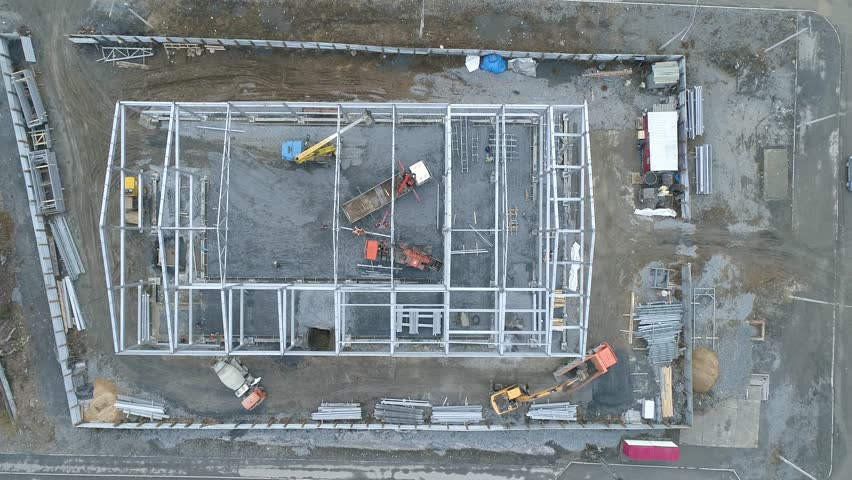 View of the building site, construction of the building, operation of the equipment and people, shooting from air | Shutterstock HD Video #1017987694