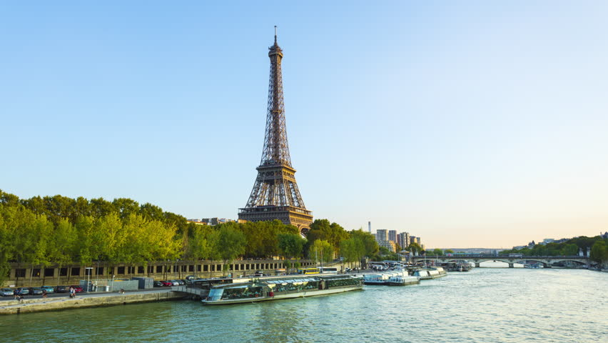 PARIS, FRANCE,  View of the Seine River with cruise tour boats. In Paris there are several boat tourist trips across the Seine to show tourists the sights of interest. | Shutterstock HD Video #1018009984