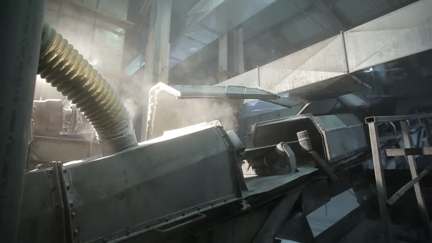 Conveyor belt transporting the pellet from the factory to loading  | Shutterstock HD Video #1018044874