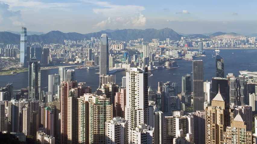 Hong kongs victoria harbour with the skyscrapers of the financial and busines | Shutterstock HD Video #1018046944
