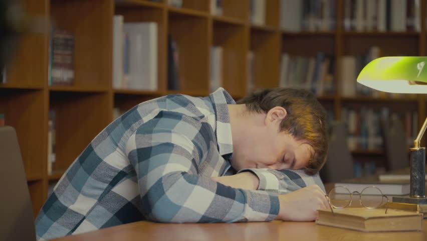 Footage portrait of man sleeping on the book. 4k education video | Shutterstock HD Video #1018086184