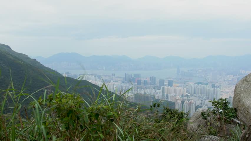 Hong Kong Skyline Kowloon from Fei Ngo Shan hill sunset | Shutterstock HD Video #1018104424
