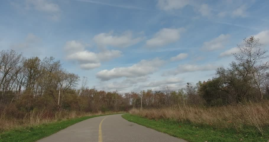 High Angle Shot Of Sky And Road Vanishing Point While Jogging Through Park Fi | Shutterstock HD Video #1018133614