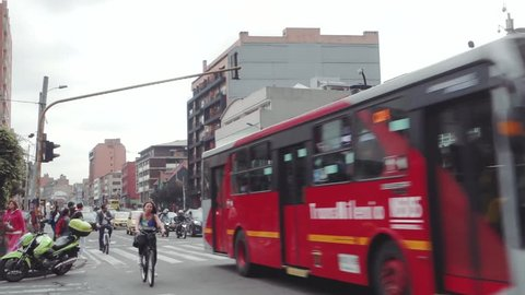 Bogotá, DC, Colombia - October 9th 2018: traffic police manage a busy intersection at rush hour in Chapinero suburb