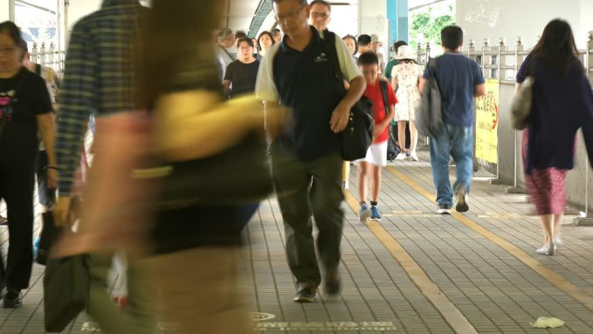 Timelapse of people moving along walk way in Hong Kong. | Shutterstock HD Video #1018164574