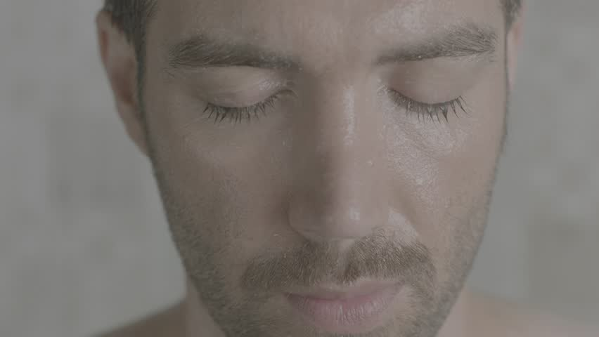 A handsome man in shower opening his eyes slow motion | Shutterstock HD Video #1018171714
