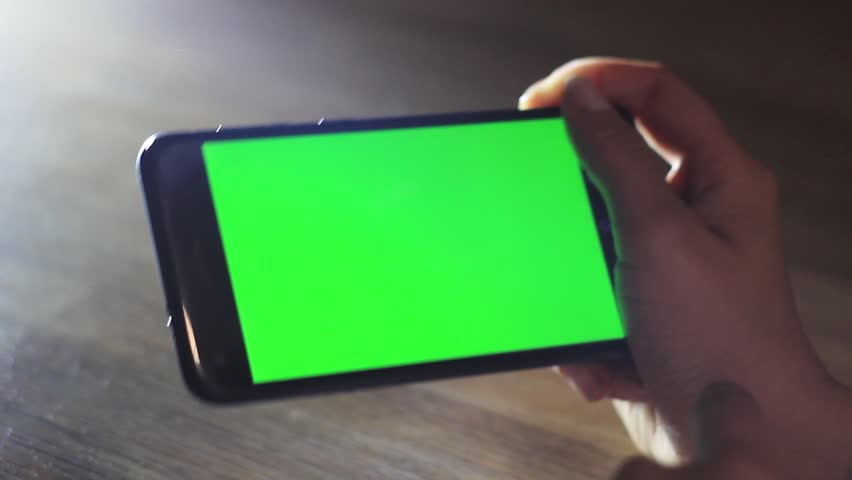 Female hands uses a mobile device with a green screen. Chroma Key   Shutterstock HD Video #1018174504