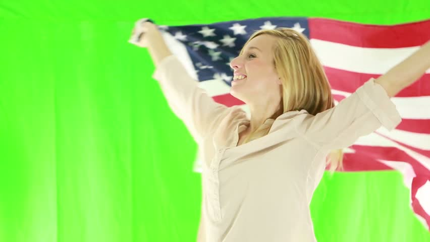 Young woman with USA flag. Green screen    Shutterstock HD Video #1018174774