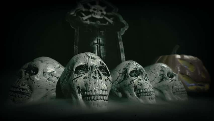 Old film look of halloween set decoration with skulls, grave and jack o'lantern - still shot   Shutterstock HD Video #1018184704