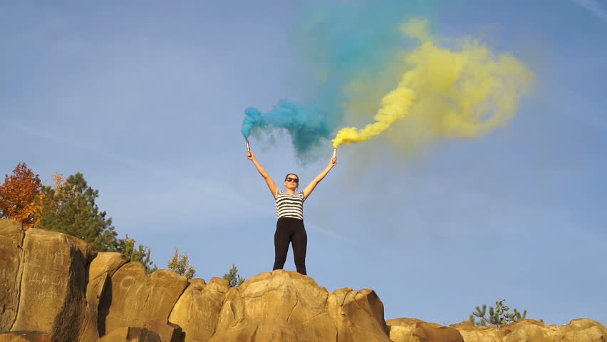 Colored Smoke Bombs  the Girl Stock Footage Video (100% Royalty-free)  1018188844   Shutterstock