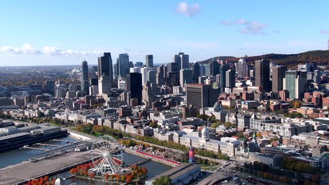 Aerial view of Downtown buildings and Old Port of Montreal in the Fall season in Montreal, Quebec, Canada.