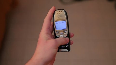 BUDAPEST, HUNGARY - OCTOBER 13, 2017: Classic Nokia 6310i cellphone turned on, displaying welcome animation