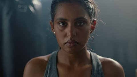 portrait beautiful kickboxing woman fighter looking confident at camera tough female kickboxer fierce sportswoman sweating after training in fitness gym close up