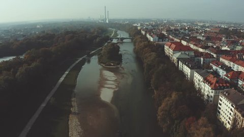 Modern cityscape in Munich, European City .  River Isar running through the middle of the town in late summer mood
