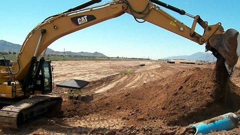 Phoenix, Arizona / United States - 07 13 2018: Caterpillar 349 Excavator working on highway construction.