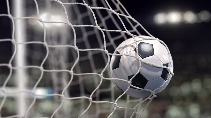 A Soccer ball flies into the net on a stadium with spot lights. The movement at the beginning is accelerated then slowly. Beautiful close-up (4k, 3840x2160, ultra high definition) #1018423564