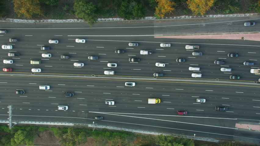 Aerial overhead city view of suburban multi lane vehicle Freeway traffic busy commuter highway Los Angeles Southern California America RED WEAPON   Shutterstock HD Video #1018440034