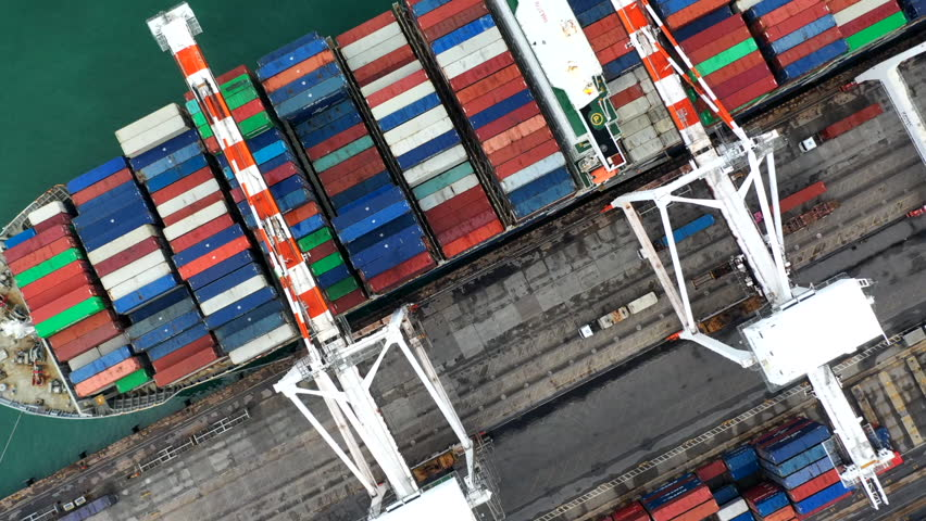 Aerial top view crane shipping container, cargo container ship carrying container import and export business logistic and transportation. | Shutterstock HD Video #1018513954