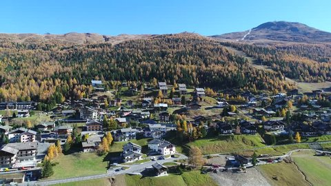 Village of Teola (Livigno). Forest and chalets in the Italian Alps