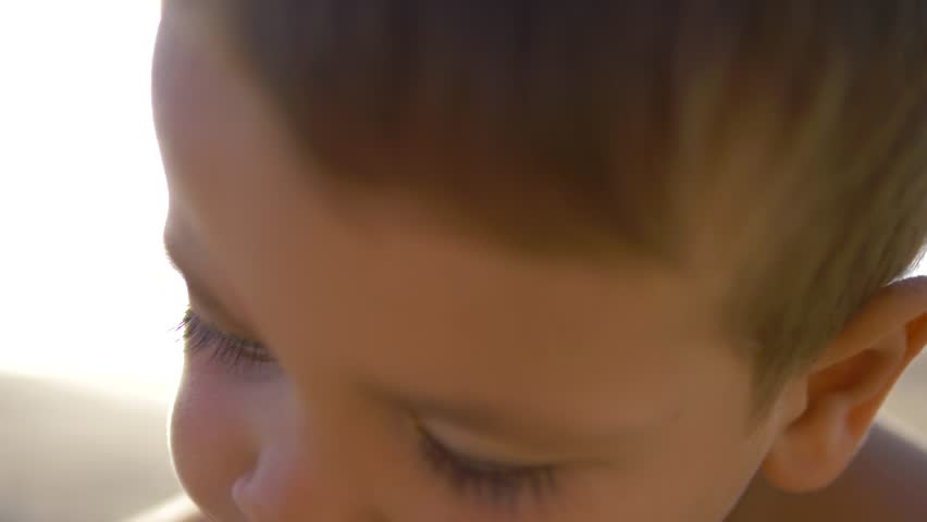 4K Slow motion - Caucasian Child with blue eyes looking at the camera in a sunny day | Shutterstock HD Video #1018539064