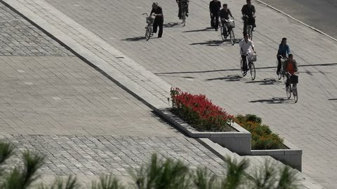 North Korea, HAMHUNG, streetlife with cyclists on a normal weekday, September 2018
