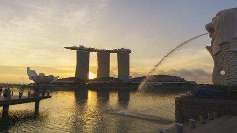 Marina Bay, Singapore - October 2018 - Timelapse of sunrise moment at Merlion Park facing Marina Bay Sands hotel. motion panning left.