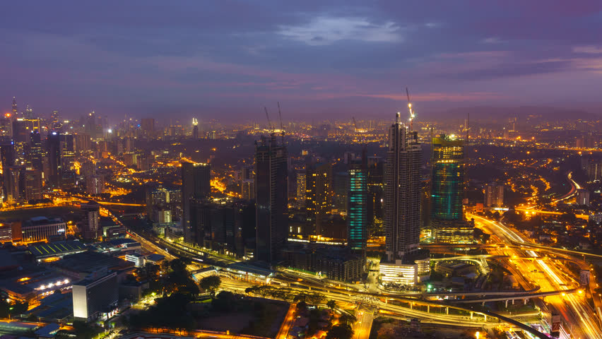 A cold and blue dawn at Kuala Lumpur city from high vantage point of view. Visibility is low due to haze condition. Time lapse, Wide Angle shot, Pan Left | Shutterstock HD Video #1018667794
