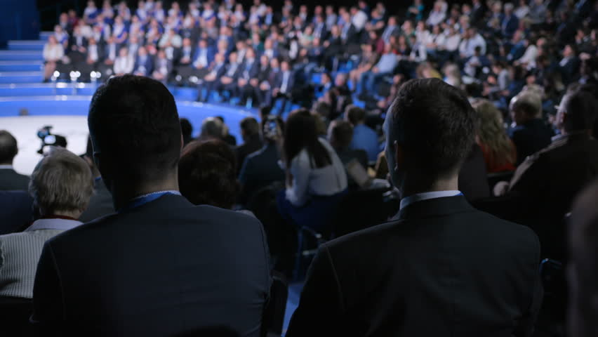 Crowd at official congress for cooperation solution or modern education. Economic concept of strategy briefing for partner or politician team. Row of seats in large room for listener or spectator   Shutterstock HD Video #1018680304