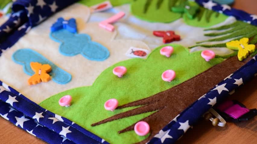 Little baby education felt hand made book playing hands close up | Shutterstock HD Video #1018725784