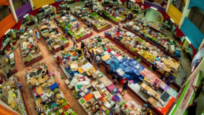Time Lapse - Blurry Scene at Siti Khadijah Market, Kelantan, Malaysia. People buying vegetables and groceries.