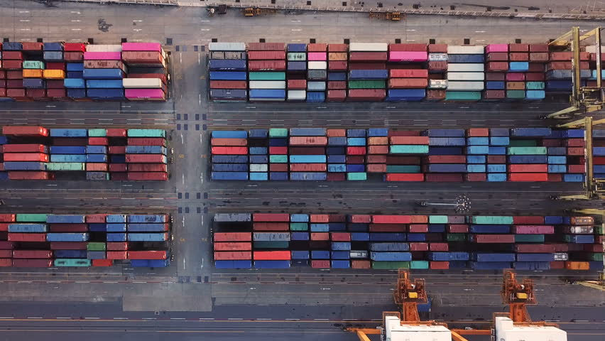 Aerial top view of container cargo ship in the export and import business and logistics international goods in urban city. Shipping cargo to the harbor by crane. | Shutterstock HD Video #1018873204