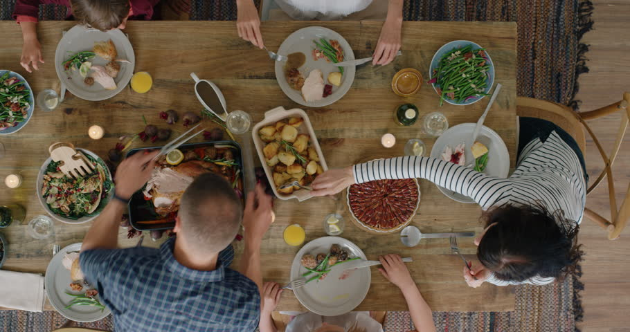 Top view happy family enjoying thanksgiving lunch together enjoying tasty homemade feast holiday celebration meal overhead tracking | Shutterstock HD Video #1018898254