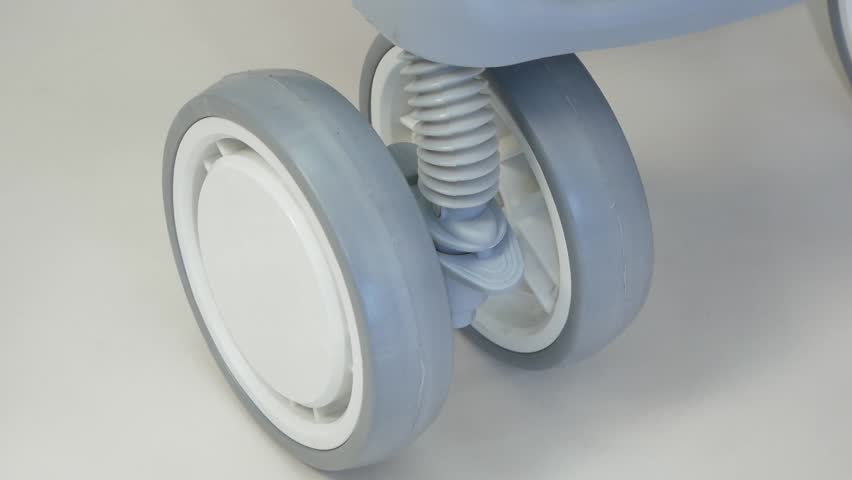 Baby Stroller, Carriage, Pram in Park; Close Up Shot of Stroller Front Wheels | Shutterstock HD Video #1018916344