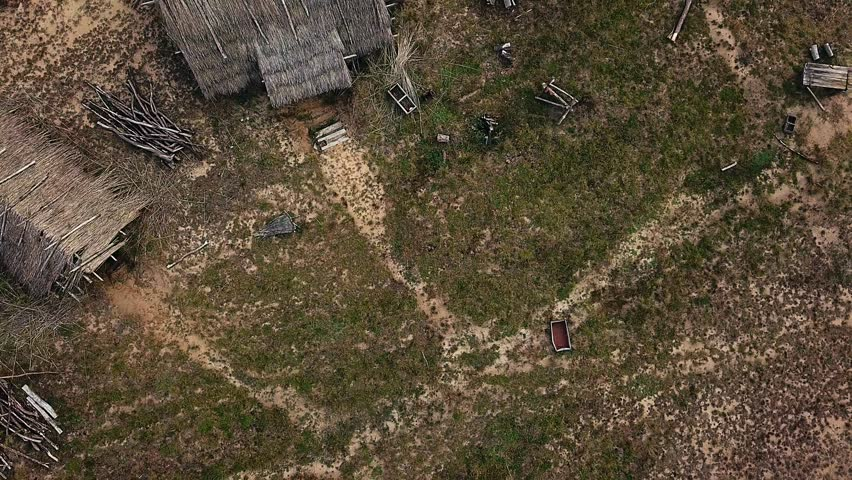 aerial view of Old wooden structures covered with straw, top view of old abandoned farm, evening in the old village,Traditional Ukrainian village in summer, Old rural country wooden house in village