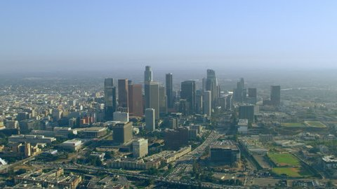 Aerial view downtown skyline on a sunny day in Los Angeles, California. Shot on 4K RED camera.