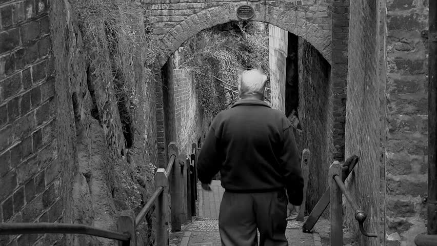 Old man walking down steps in Bridgnorth, in the United Kingdom Both Color and black and white versions from 5, 10, 15 seconds to long version. | Shutterstock HD Video #1019012194