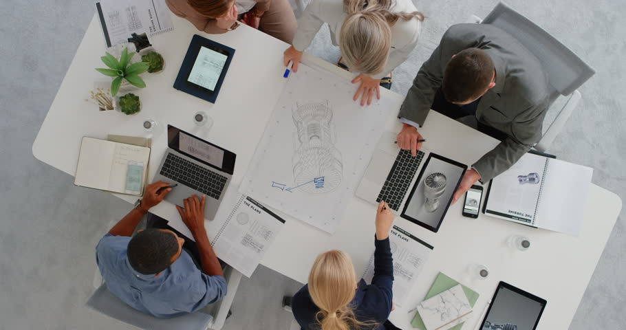Diverse business people engineers planning turbine project brainstorming working on design schematics in corporate boardroom meeting using 3d render overhead | Shutterstock HD Video #1019014864