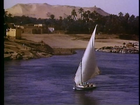 ASWAN, EGYPT, 1977, The Nile River, feluccas, sailboats, close up, one boat