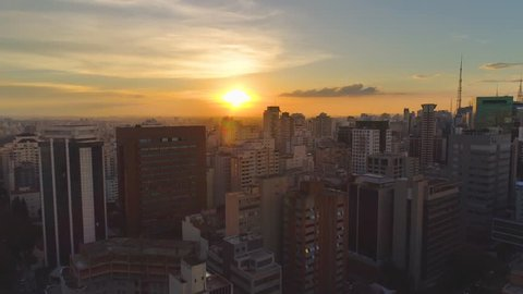 SAO PAULO, BRAZIL - MAY 3, 2018: Aerial view of city centre on sunset, residental and business buildings in downtown from above. Drone shot in 4K