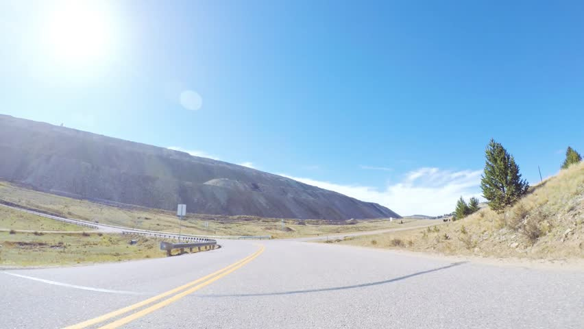 Driving on mountain highway 67 to Cripple Creek from Victor in Autumn. | Shutterstock HD Video #1019126314