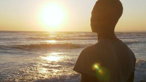 Migration,refugee,Homeland. Sad black man looking the sea at sunset