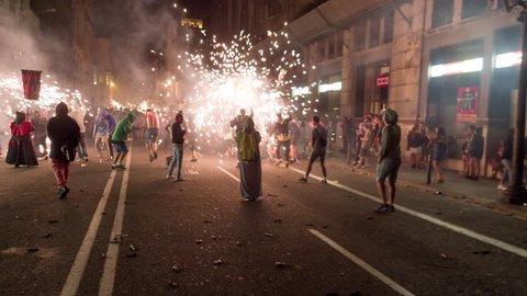 Barcelona, Spain - September 22 2018 : Crowds in the street for the fire run, correfoc during la merce festival.