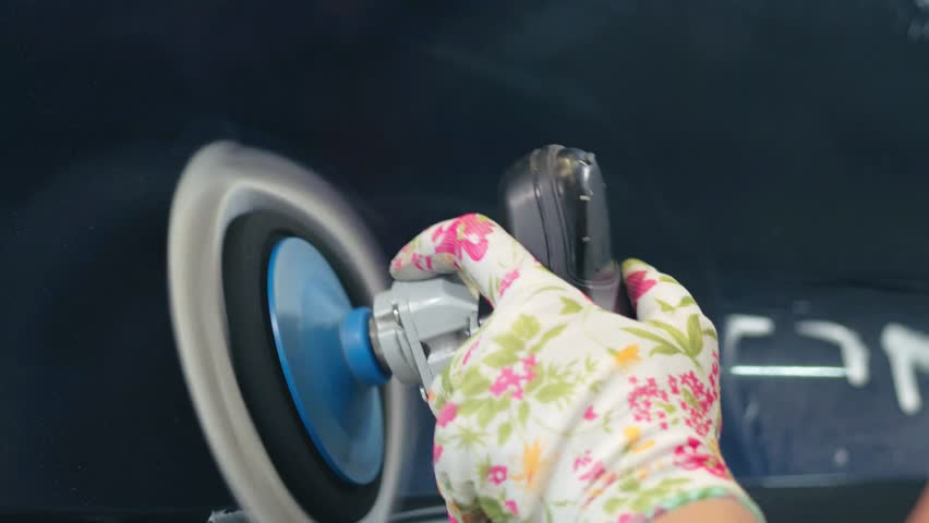 Female hand making car body polishing with polisher in service. Close up woman worker making waxing car at car wash. Car body work | Shutterstock HD Video #1019339344