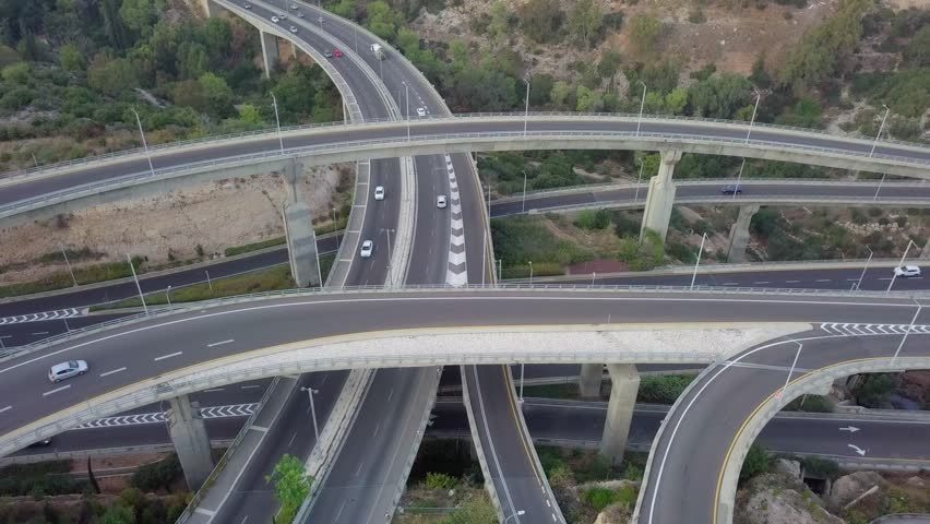 Multi level Highway interchange with traffic on all levels - Aerial footage | Shutterstock HD Video #1019390614