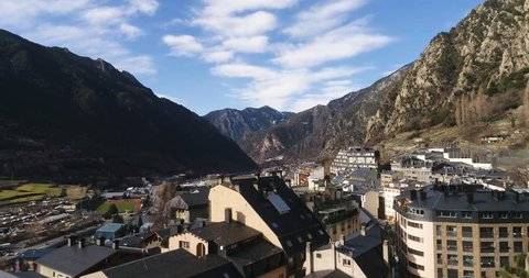 4k. Travel, drone view. Andorra. Europe. Sun shines over the summeries and blue sky. Little town between the mountains. Modern architecture