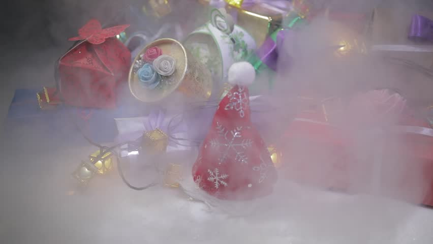 Christmas or New Year gifts with ribbon in snow on bokeh background. Stack of colorful gift boxes. Copy space for text. Winter card. Holiday and celebration concept. | Shutterstock HD Video #1019592004