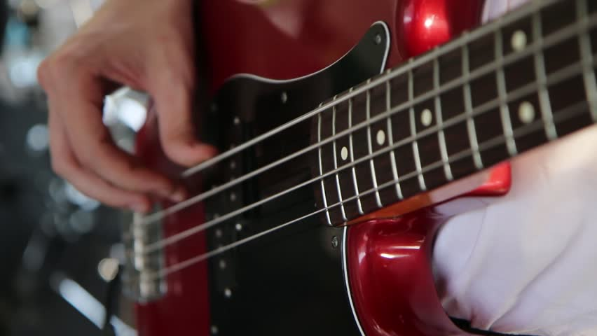 The performance of the bass guitar. | Shutterstock HD Video #1019659444